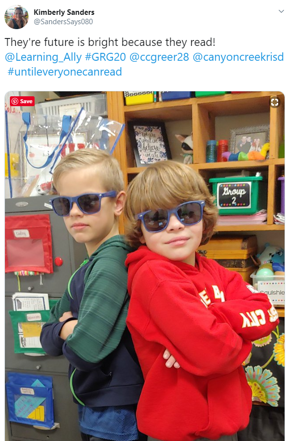 Kimberly Sanders tweets: They're future is bright because they read! The photo shows two confident boys in cool sunglasses.