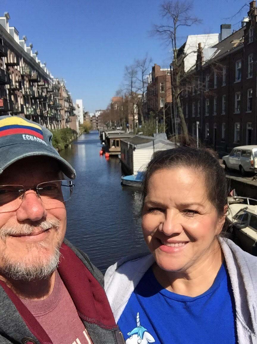 Steve (left) and Myra (Right) pose in front of a canal in Amsterdam.